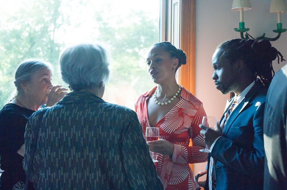 Dr. Sierra Washington speaks with guests at a cocktail reception in June.