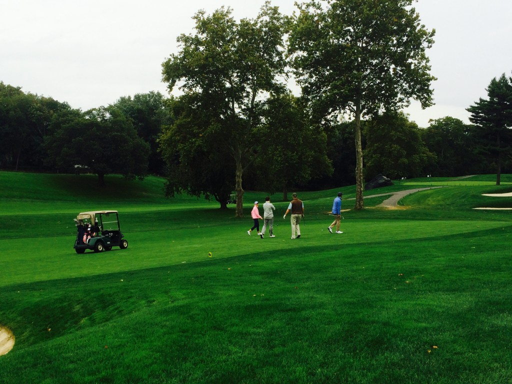 Kupona's supporters take to the green to golf for good.